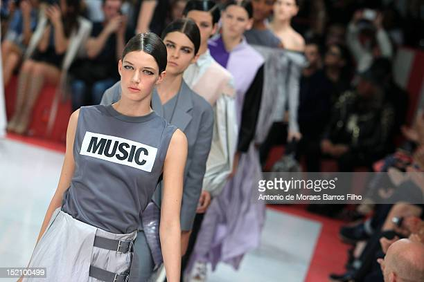 A model showcases designs on the catwalk by Acne on day 3 of London Fashion Week Spring/Summer 2013 at Park House on September 16 2012 in London...