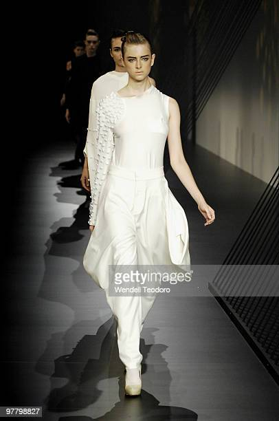 A model showcases designs on the catwalk by Albert Lee as part of L'Oreal Paris Runway 5 on the third day of the 2010 L'Oreal Melbourne Fashion...