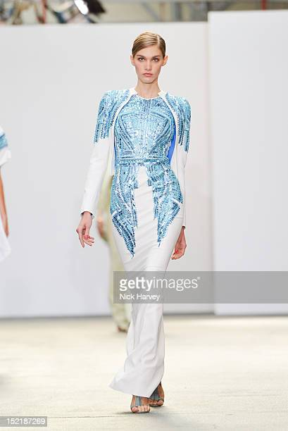 A model showcases designs on the catwalk by Antonio Berardi on day 4 of London Fashion Week Spring/Summer 2013 at NCP carpark Lexington Street on...