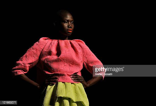 A model showcases designs on the catwalk by Camilla Marc during A Review Of Australian Fashion Week show as part of Mercedes Benz Fashion Festival...
