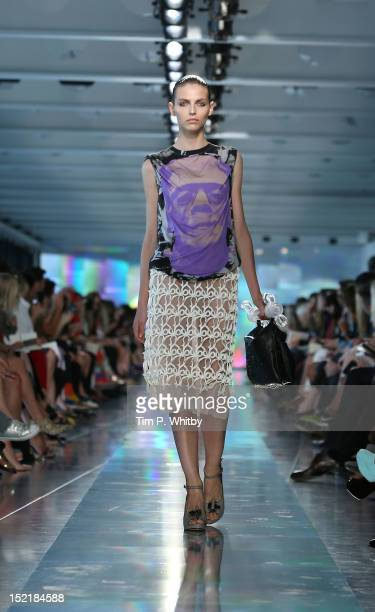Model showcases designs on the catwalk by Christopher Kane on day 4 of London Fashion Week Spring/Summer 2013, at Park House on September 17, 2012 in...