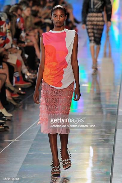 Model showcases designs on the catwalk by Christopher Kane on day 4 of London Fashion Week Spring/Summer 2013 on September 17, 2012 in London,...