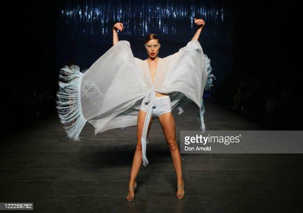 A model showcases designs on the catwalk by MS Couture during A Review of Australian Fashion Week show as part of Mercedes Benz Fashion Festival...