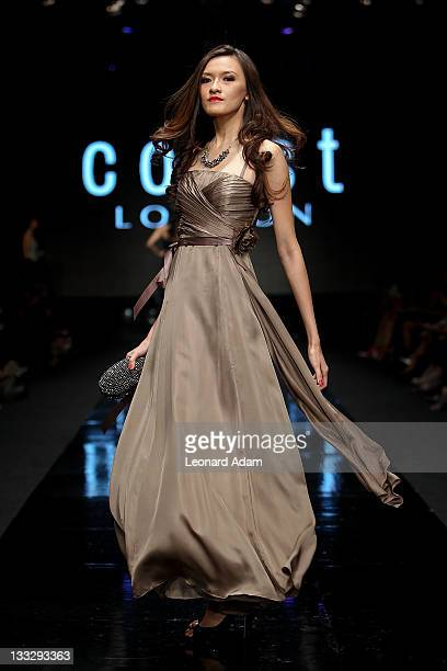 A model showcases designs on the catwalk by designer Coast during Jakarta Fashion Week 2012 show at Pacific Place on November 18 2011 in Jakarta...