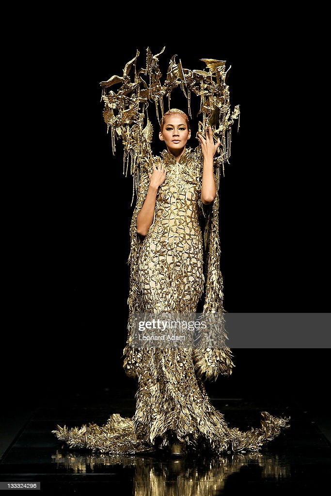A model showcases designs on the catwalk by designer Tex Saverio during Jakarta Fashion Week 2012 show at Pacific Place on November 18, 2011 in Jakarta, Indonesia.