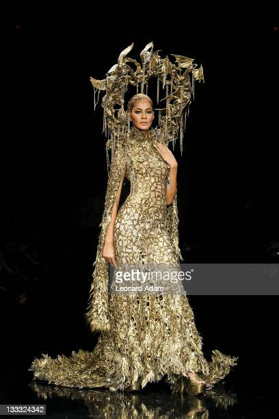A model showcases designs on the catwalk by designer Tex Saverio during Jakarta Fashion Week 2012 show at Pacific Place on November 18 2011 in...