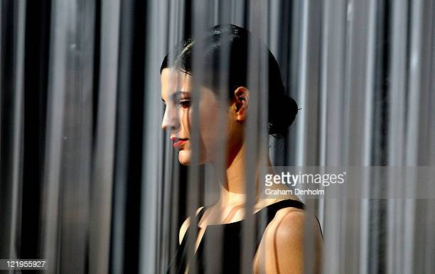 A model showcases designs on the catwalk by Dion Lee during the Review Of Australian Fashion show as part of Mercedes Benz Fashion Festival Sydney...