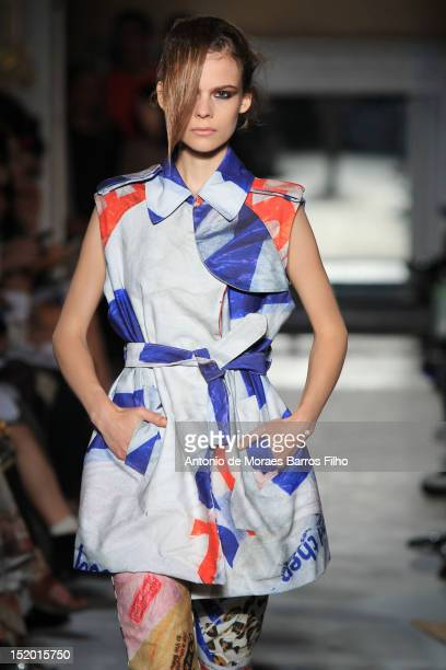 A model showcases designs on the catwalk by Fashion East on day 2 of London Fashion Week Spring/Summer 2013 at 50 St James Street on September 15...