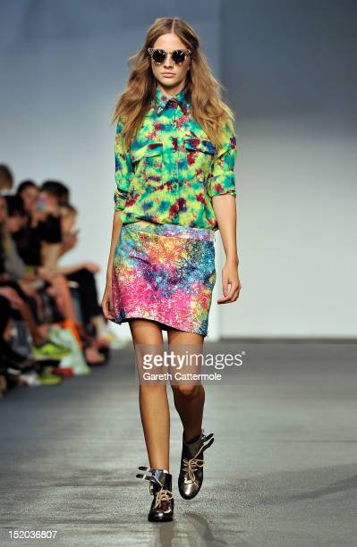 A model showcases designs on the catwalk by House Of Holland on day 2 of London Fashion Week Spring/Summer 2013 at Brewer St Car Park on September 15...