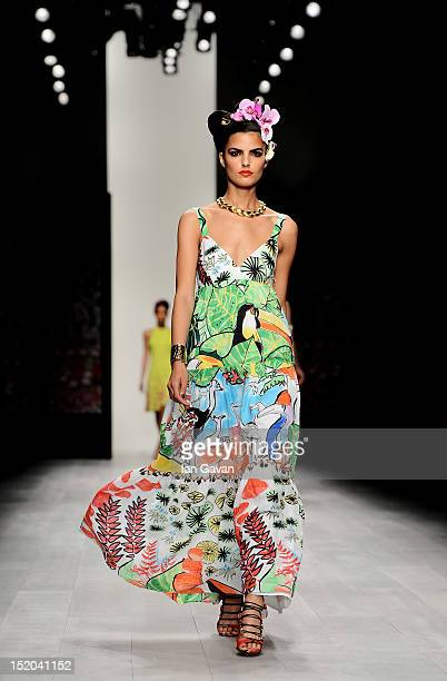 A model showcases designs on the catwalk by Issa London on day 2 of London Fashion Week Spring/Summer 2013 at The Courtyard Show Space on September...