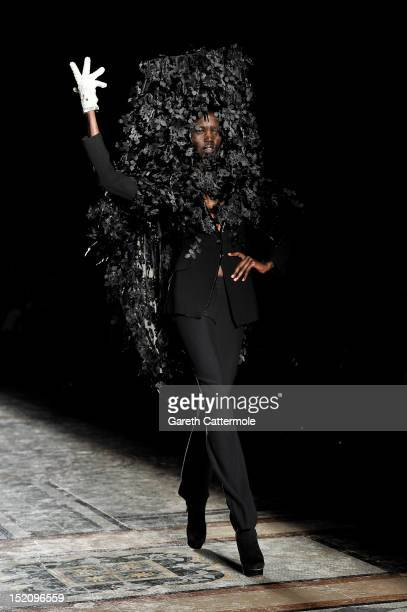 A model showcases designs on the catwalk by Philip Treacy on day 3 of London Fashion Week Spring/Summer 2013 at The Royal Courts Of Justice on...