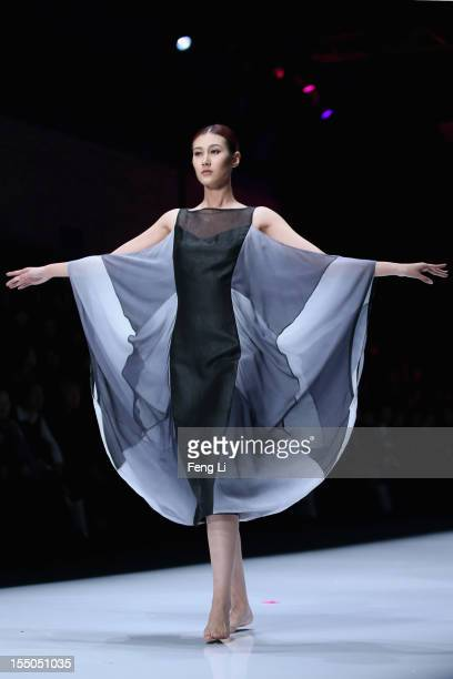A model showcases designs on the catwalk during China Fashion Designer Top Award Winners Collection of China Fashion Week S/S Collection 2013 on...