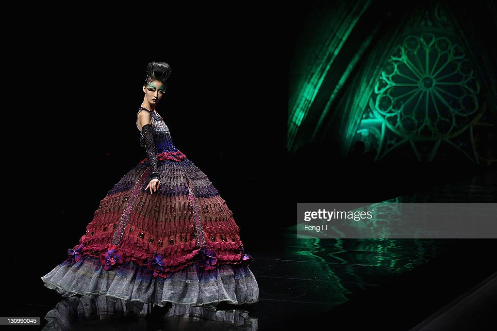 A model showcases designs on the catwalk during Deng Hao Haute Couture 2012 of China Fashion Week Spring/Summer 2012 on October 31, 2011 in Beijing, China.