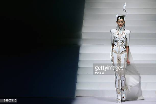 A model showcases designs on the catwalk during Hempel Award the 21st China International Young Fashion Designers Contest on the second day of...