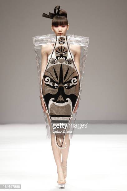 A model showcases designs on the catwalk during Minzu University of China Collection on the four th day of MercedesBenz China Fashion Week...