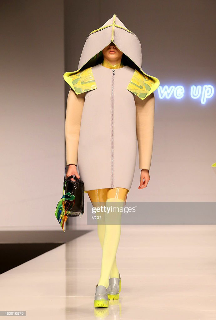 A model showcases designs on the catwalk during the Beijing Institute of Fashion Technology - Shih Chien University Emerging Design Collection & 'BIFT-ELLASSAY' Scholarship Awarding Ceremony on the second day of Mercedes-Benz China Fashion Week Autumn/Winter 2014/2015 a on March 26, 2014 in Beijing, China.