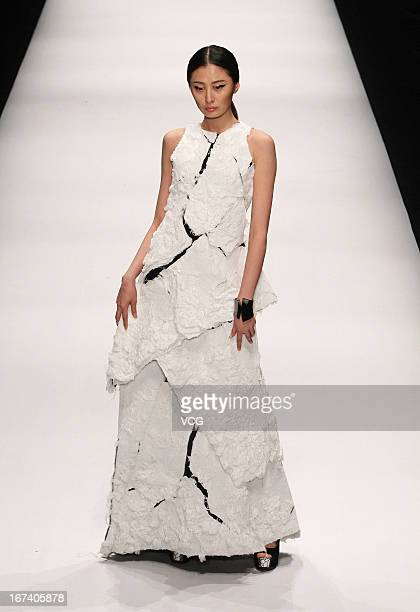 Model showcases designs on the catwalk during the China Academy of Arts School of Design Graduates Show on the first day of China Graduate Fashion...