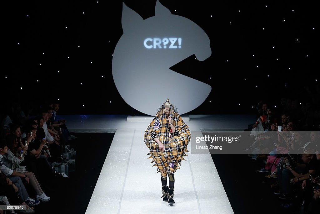 A model showcases designs on the catwalk during the CRZ Collection show of Mercedes-Benz China Fashion Week Autumn/Winter 2014/2015 at the 751D-PARK Central Hall on March 26, 2014 in Beijing, China.