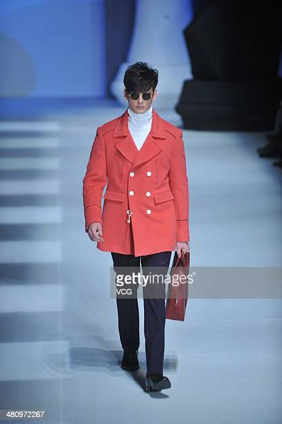Model showcases designs on the catwalk during the Edenbo Collection show on the third day of Mercedes-Benz China Fashion Week Autumn/Winter 2014/2015...