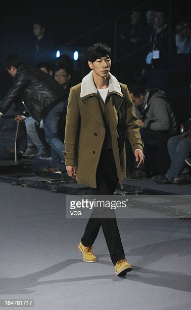 Model showcases designs on the catwalk during the EDENBO Men's Business Casual collection show on the fourth day of Mercedes-Benz China Fashion Week...