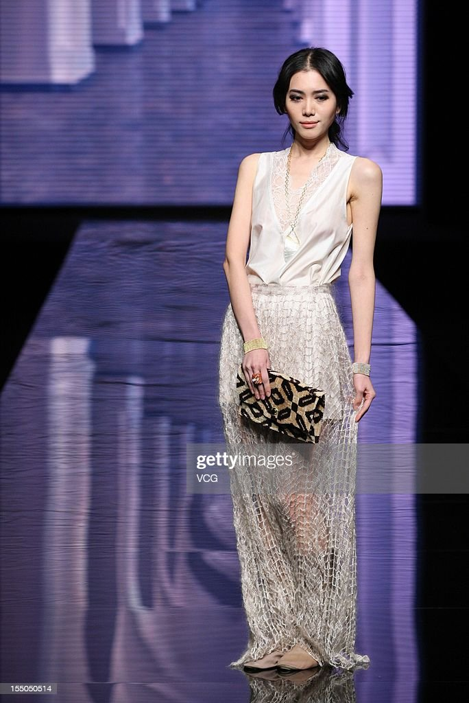 A model showcases designs on the catwalk during the Guli collections show on the sixth day of China Fashion Week S/S Collection 2013 at Beijing Hotel on October 30, 2012 in Beijing, China.