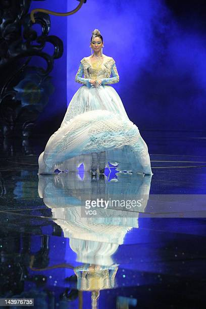 Model showcases designs on the catwalk during the Guo Pei 2013 Dragon Bride show at 751 D.PARK on May 6, 2012 in Beijing, China.