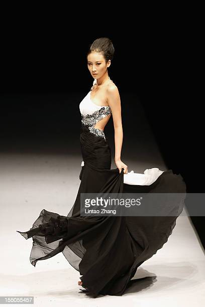 A model showcases designs on the catwalk during the JOOOYS Zhao Yakun Haute Couture Collection of the China Fashion Week S/S Collection 2013 at 751...