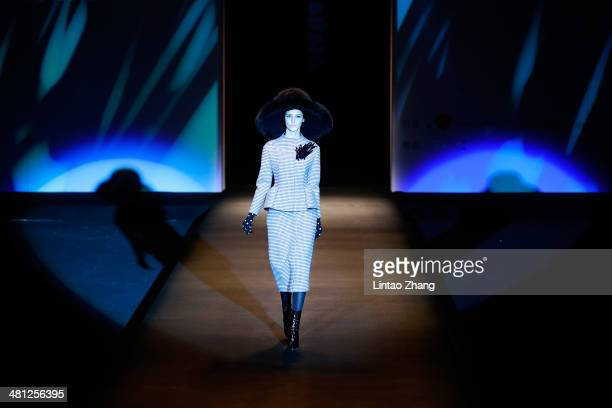 A model showcases designs on the catwalk during the Korean Fashion Designer Joint Collection show of MercedesBenz China Fashion Week Autumn/Winter...