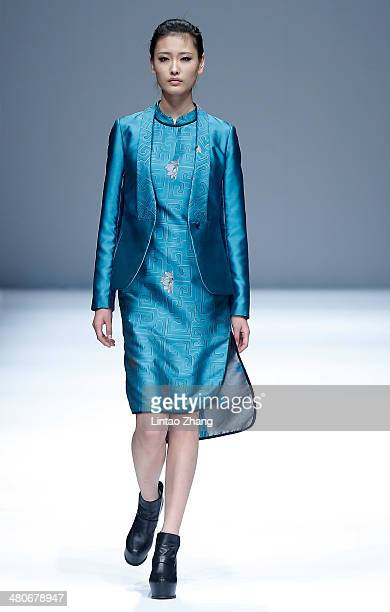 A model showcases designs on the catwalk during the LIANVIS Lian Huiqing Collection show of MercedesBenz China Fashion Week Autumn/Winter 2014/2015...