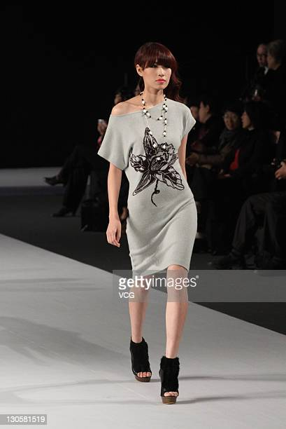 A model showcases designs on the catwalk during the Rabbit WarmZhuang Ganran Dehaired Angora collection show on the third day of China Fashion Week...