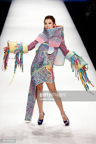 Model showcases designs on the catwalk during the Tianjin Polytechnic University School of Art and Clothing Graduates Show on the second day of China...