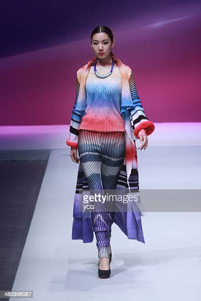 Model showcases designs on the catwalk during the WSM China Knitwear Fashion Design Contest on the third day of Mercedes-Benz China Fashion Week...