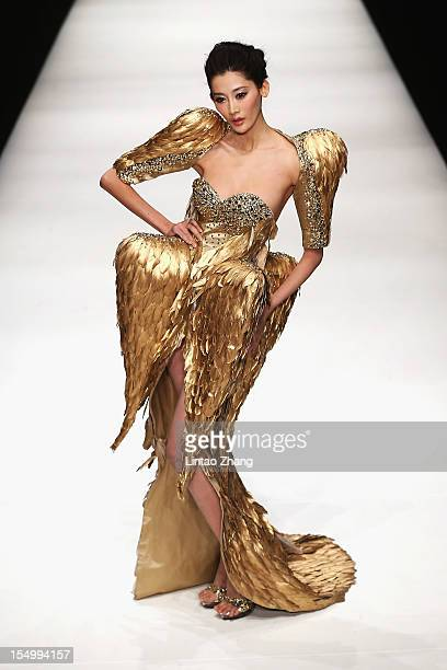 A model showcases designs on the catwalk during the Zhang jingjing Haute Couture Collection of China Fashion Week S/S Collection 2013 at 751DPARK...