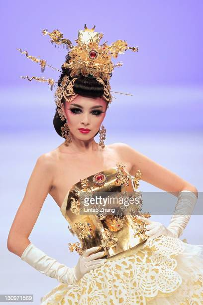A model showcases designs on the catwalk during Tsai Meiyue Wedding Dress S/S 2012 of China Fashion Week Spring/Summer 2012 at the Banquet Hall...