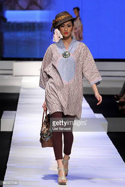 A model showcases designs on the runway as part of the DKI show on day four of Jakarta Fashion Week 2009 at the Fashion Tent Pacific Place on...
