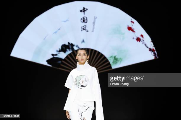Model showcases designs on the runway at Art Institute of Beijing Union University Show during the day two of China Graduate Fashion Week at the 751...