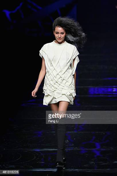 A model showcases designs on the runway at Asahi Kasei Chinese Fashion Designer Creativity Award Gioia Pan Collection Show during MercedesBenz China...