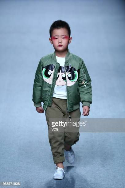 A model showcases designs on the runway at BEIBEI CHILD HOOD show by Designer Feng Sansan on day three of MercedesBenz China Fashion Week...