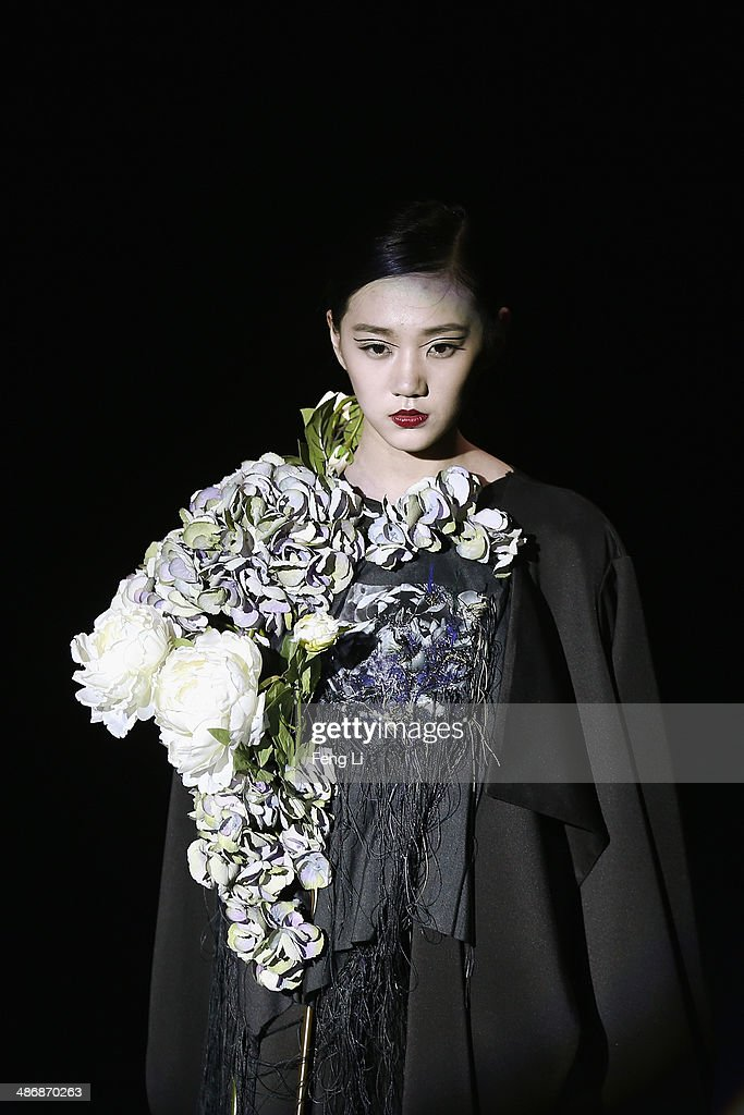 A model showcases designs on the runway at Beijing Institute of Fashion Technology Graduates Show during the 2014 China Graduate Fashion Week at the 751D.Park workshop on April 26, 2014 in Beijing, China.