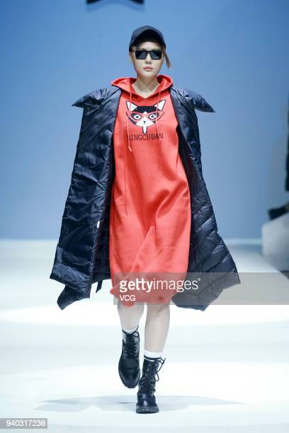 A model showcases designs on the runway at BINGCHUAN show by designer Sun Yiwen on day six of MercedesBenz China Fashion Week Autumn/Winter 2018/2019...