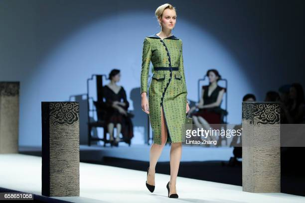 A model showcases designs on the runway at Chantel Gong by Hangyu Gong show during the MercedesBenz China Fashion Week Autumn/Winter 2017/2018 at...