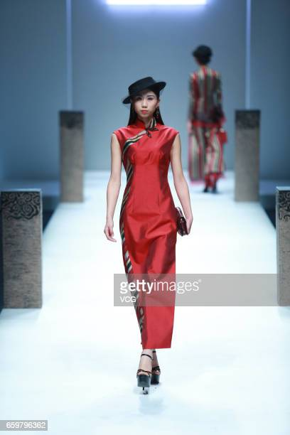 A model showcases designs on the runway at Chantel Gong collection by designer Gong Hangyu during MercedesBenz China Fashion Week Autumn/Winter...