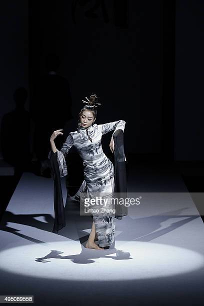 A model showcases designs on the runway at Chantel Gong Gong Hangyu Finery Collection show during the MercedesBenz China Fashion Week Spring/Summer...