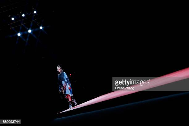 A model showcases designs on the runway at Chenwen studio collection by Chen Wen during the MercedesBenz China Fashion Week Autumn / Winter 2017/2018...