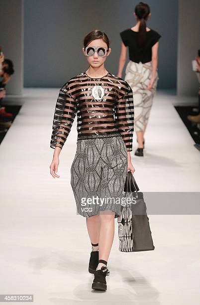 A model showcases designs on the runway at Chicca Lualdi Alberto Zambelli Collection show during the MercedesBenz China Fashion Week Spring/Summer...