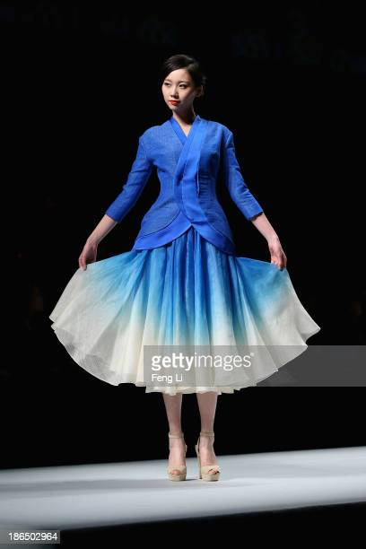 Model showcases designs on the runway at CHUHETINGXIANG Chu Yan Collection show during Mercedes-Benz China Fashion Week Spring/Summer 2014 at Beijing...