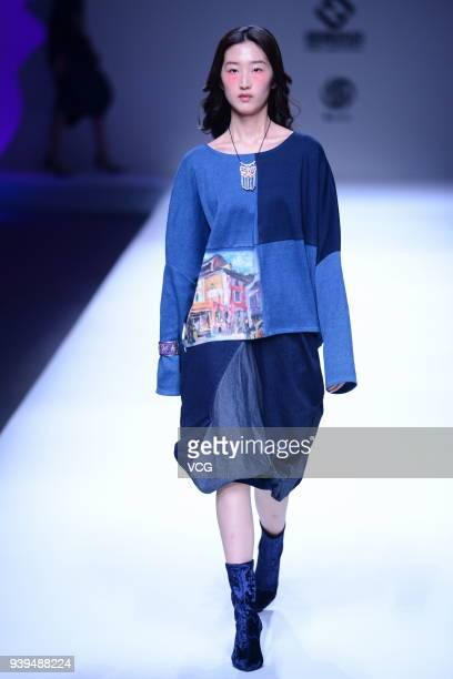 A model showcases designs on the runway at COTTON USA show by designers Chen Wen Adriano Goldschmied on day four of MercedesBenz China Fashion Week...