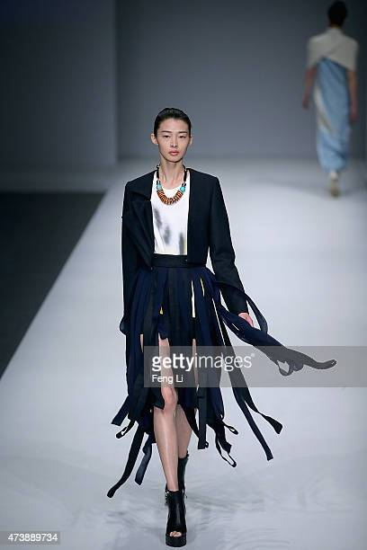 A model showcases designs on the runway at Dalian Polytechnic University and University of Southampton Graduates Show during the China Graduate...