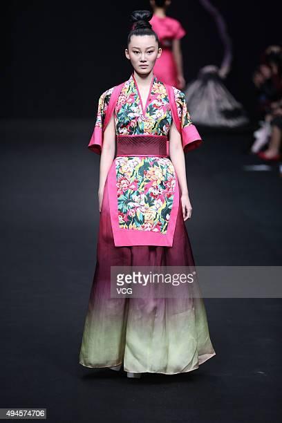 Model showcases designs on the runway at D.CNTEX Shiyong Li Collection during the Mercedes-Benz China Fashion Week Spring/Summer 2016 at 751D¡¤PARK...