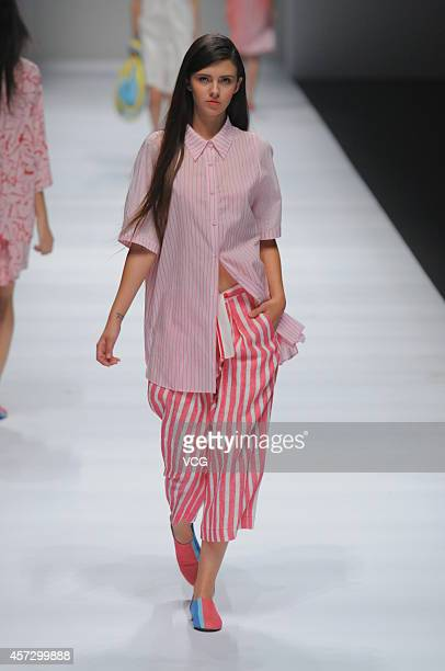 A model showcases designs on the runway at DECOSTER collection show during the second day of the Shanghai Fashion Week 2015 Spring/Summer at Taiping...